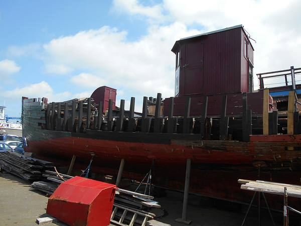 SEAN HORGAN/Staff photo/Work to restore the Phyllis A. conitnues at the Gloucester Marine Railways on Rocky Neck.