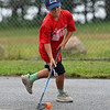 RYAN HUTTON/ Staff photo<br /> The Red Wings' Isiah Francis dribbles the ball downcourt toward the Flyers' net during the Young Legends Youth Street Hockey League's finals at the Stage Fort Park basketball courts on Sunday.