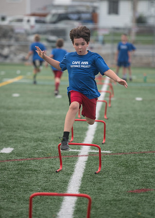 Desi Smith Photo.   Thomas Robbins 9, stays focused as he leaps over small hurdles during the Youth Track and Field, held late Wednesday afternoon at the New Balance Track and Field at Newell Stadium.     August 1,2018