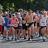 MIKE SPRINGER/Staff photo<br /> Runners leave the starting line in the annual Magnolia 5K Road Race Saturday morning in Gloucester. Number 49 at far left, Dan O'Flynn of Ipswich, ended up winning the race. To the right of O'Flynn, checking her watch, is Manchester's Leslie Linstra, who went on to win the women's race.