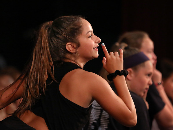 MIKE SPRINGER/Staff photo<br /> Eighth-grader Emma Allen rehearses a scene in the O'Maley Academy Musical Theater Camp's musical review at Gloucester High School. Over 100 O'Maley Middle School students are partipating in the production, which has been moved to the GHS auditorium due to problems with the middle school's air conditioning system. The show will be presented free to the public at 12 noon on Friday.<br /> 8/13/2018