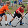 RYAN HUTTON/ Staff photo<br /> The Flyers' Chris Daily, left, tries to grab the ball from the Red Wings' Chase Brown, right, during the Young Legends Youth Street Hockey League's finals at the Stage Fort Park basketball courts on Sunday.