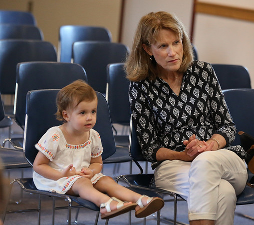 MIKE SPRINGER/Staff photo<br /> Two-year-old Collins Care and her grandmother Marty Holdridge enjoy a puppet and music show for children Thursday at the Rockport Public Library.<br /> 8/9/2018