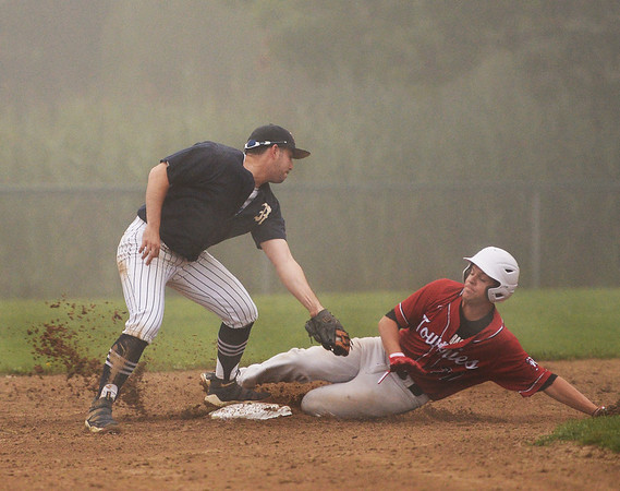 CARL RUSSO/staff photo GLOUCESTER TIMES: Manchester Mariner's Calvin Rogers puts the tag on Rockport Townies' Nolan Webb for the out as he slides into second base attempting to steal. The Manchester Mariners defeated the Rockport Townies in the first game of the ITL FInals. 8/13/2018