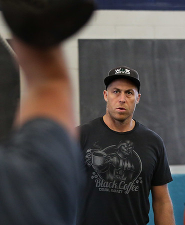 MIKE SPRINGER/Staff photo Coach John Conant, proprietor of Crossfit Cape Ann, leads a kettlebell fitness class. 8/14/2018