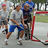 RYAN HUTTON/ Staff photo<br /> The Rangers Jack Costanzo chases the ball behind the Maple Leafs goal during the Young Legends Youth Street Hockey League's finals at the Stage Fort Park basketball courts on Sunday.