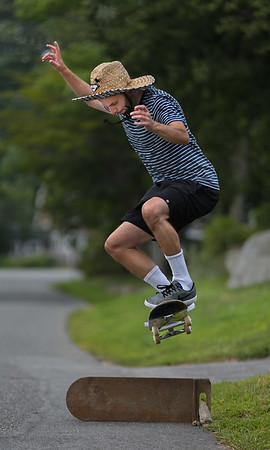 MIKE SPRINGER/Staff photo<br /> Christopher McGrath, visiting from Seattle, uses a skateboard to jump over another skateboard Tuesday in Magnolia.<br /> 8/7/2018