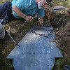 MIKE SPRINGER/Staff photo<br /> John Straw of Hampton, New Hampshire works on restoring a slate tombstone from 1810 on Friday at the First Parish Burial Grounds in Gloucester. Straw was one of over 20 participants from around the eastern U.S. participating in the two-day preservation workshop, sponsored by the Gloucester Cemetery Advisory Committee and led by teachers from the National Park Service and the Preservation Trades Network.<br /> 8/3/2018