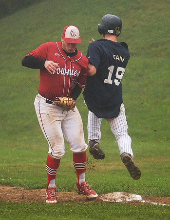 CARL RUSSO/staff photo GLOUCESTER TIMES: Manchester Mariner Mike Cain sprints across first base but Rockport Townie first baseman Keady Segal makes the  out. Cain argued the close call. The Manchester Mariners defeated the Rockport Townies in the first game of the ITL FInals. 8/13/2018
