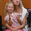 "MIKE SPRINGER/Staff photo<br /> Gigi Gladchun and her granddaughter Marlowe, 4, enjoy a performance Friday of ""The Spoon Man"" at the Sawyer Free Library. <br /> 8/10/2018"