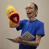 "MIKE SPRINGER/Staff photo<br /> Rick Goldin of Lowell performs with his puppet, ""Quackleberry Duck,"" during a musical program for children Thursday at the Rockport Public Library.<br /> 8/9/2018"