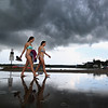 MIKE SPRINGER/Staff photo<br /> Sophie Bertocci, left, and Olivia Liberti walk home from the beach following a heavy rainfall Friday afternoon at Conomo Point in Essex.<br /> 8/3/2018