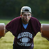 MIKE SPRINGER/Staff photo<br /> Varsity football captain Marc Smith leads a drill on the sled during a special Youth Fishermen football practice with GHS varsity coaches and captains Thursday at the Green Street field in Gloucester. <br /> 8/16/2018