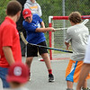 RYAN HUTTON/ Staff photo<br /> The Maple Leafs' Owen McNally fires a pass down court during the Young Legends Youth Street Hockey League's finals at the Stage Fort Park basketball courts on Sunday.