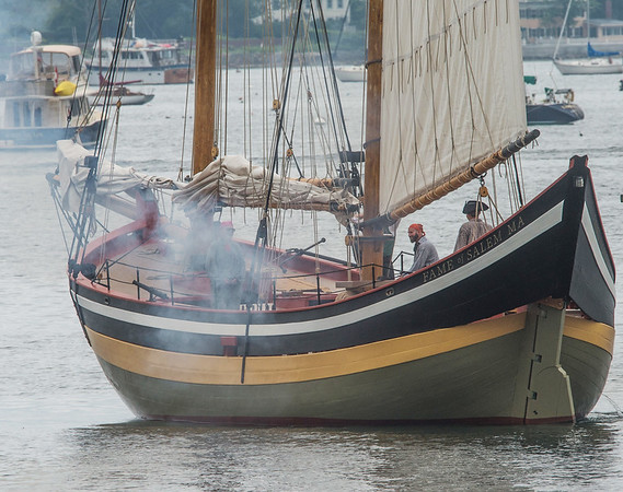 Desi Smith Photo.   Revolutionary solders return fire onboard the schooner Fame during a reenactment of the 1775 Battle of Gloucester on the Outer Harbor, off Pavilon Beach Saturday morning.  August 11,2018.