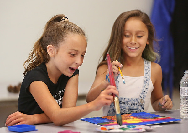 """MIKE SPRINGER/Staff photo<br /> Ten-year-old Emma Alves, left, and Janessa Tavares, 7, take part in the """"Summer Art for Kids"""" program Wednesday at Cape Ann Art Haven in Gloucester.<br /> 8/1/2018"""