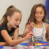 "MIKE SPRINGER/Staff photo<br /> Ten-year-old Emma Alves, left, and Janessa Tavares, 7, take part in the ""Summer Art for Kids"" program Wednesday at Cape Ann Art Haven in Gloucester.<br /> 8/1/2018"