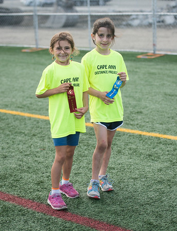 Desi Smith Photo.     From left, Samantha Tucker and Brook Woods both 7, proudly hold their first and second place finishes in the 100 yard dash, while participating in the Youth Track and Field,late Wednesday afternoon at New Balance Track and Field at Newell Stadium.     August 1,2018