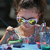 "MIKE SPRINGER/Staff photo<br /> Five-year-old Vida Silva paints a ""Glosta Rock"" at the BankGloucester booth Thursday during the Downtown Sidewalk Bazaar in Gloucester.<br /> 8/2/2018"