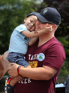 MIKE SPRINGER/Staff photo Two-year-old Will Bren is held by his father, Craig, during an event in his honor Tuesday at Gloucester police headquarters. 8/14/2018