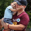 MIKE SPRINGER/Staff photo<br /> Two-year-old Will Bren is held by his father, Craig, during an event in his honor Tuesday at Gloucester police headquarters.<br /> 8/14/2018