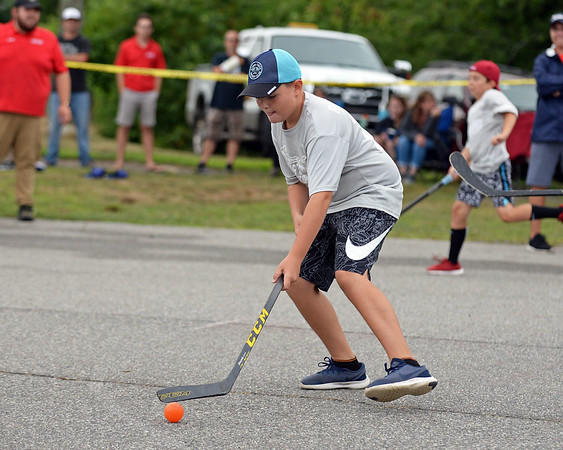 RYAN HUTTON/ Staff photo<br /> The Rangers' Chris Karvelas readies a shot on the Blackhawks' goal during the Young Legends Youth Street Hockey League's finals at the Stage Fort Park basketball courts on Sunday.
