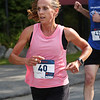 MIKE SPRINGER/Staff photo<br /> Leslie Linstra of Manchester runs to victory in the women's race Saturday in the annual Magnolia 5K Road Race in Gloucester.<br /> 8/25/2018