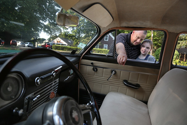 MIKE SPRINGER/Staff photo<br /> David Desmond and his daughter Abigail, 9, examine the inside of an old Packard during the annual antique car show Wednesday at the Den Mar Health and Rehabilitation Center in Rockport. <br /> 8/15/2018