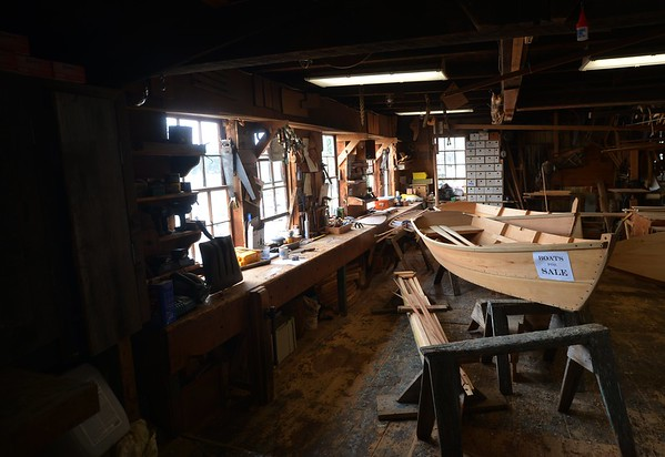JIM VAIKNORAS/Staff photo Light pours in windows at Lowell's Boat shop in Amesbury illuminating tools, boats and workspace . The shop will be celebrating it's 225th Anniversary Saturday. [[MER1808171419134231]]