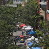 MIKE SPRINGER/Staff photo<br /> People and tents line the street Friday during the second day of the Gloucester Downtown Association's 60th annual Sidewalk Bazaar on Main Street in Gloucester.<br /> 8/3/2018