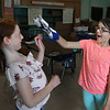 "MIKE SPRIGER/Staff photo<br /> Sixth-grader Hannah Olson, right, gives classmate Miley Courtemanche a close-up view of their finished ""space glove"" during a STEAM (Science, Technology, Engineering, Art and Mathematics) Camp project Thursday at Beeman Elementary School in Gloucester. The project, part of the Museum of Science's ""Engineering Adventures"" program was designed to teach the students how to solve engineering problems to select the right materials and make a glove that could withstand certain thermal fluctuations and impacts. The six-week STEAM Camp was offered to students going into the fourth through sixth grades, and is being taught by Annemarie Wentzell and Erin Schondelmeier.<br /> 8/9/2018"