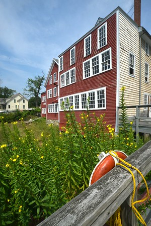 JIM VAIKNORAS/Staff photo Flowers bloom outside of Lowell's Boat shop in Amesbury. The shop will be celebrating it's 225th Anniversary Saturday. [[MER1808171419044229]]