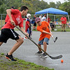 RYAN HUTTON/ Staff photo<br /> The Red Wings' Kinn Nunves, left, tries to get the ball past the Flyers' Drew Johnson, right, during the Young Legends Youth Street Hockey League's finals at the Stage Fort Park basketball courts on Sunday.