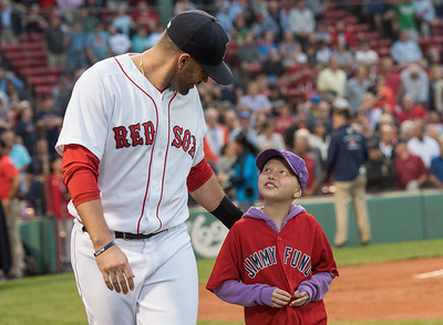 AMANDA SABGA/Staff photo   Boston Red Sox designated hitter J.D. Martinez stands at home plate with honorary designator hitter Marlin Welcome, 9, of Gloucester who has acute lymphoblastic leukemia. The Red Sox took the field with Jimmy Fund kids battling cancer before a game between the Boston Red Sox and the Cleveland Indians at Fenway Park in Boston  8/21/18