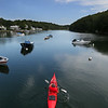 MIKE SPRINGER/Staff photo<br /> Steve Mummendey of Gloucester paddles his kayak through Lobster Cove in Annisquam.<br /> 8/9/2018