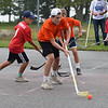 RYAN HUTTON/ Staff photo<br /> The Flyers' Michael Nocella looks for an open teammate to pass to during the Young Legends Youth Street Hockey League's finals at the Stage Fort Park basketball courts on Sunday.