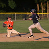 MIKE SPRINGER/Staff photo<br /> Beverly second baseman John Biszza prepares to throw Rory Gentile of Manchester Essex out at second during ITL playoff action Monday in Beverly.<br /> 8/18/2018