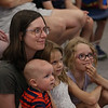 MIKE SPRINGER/Staff photo<br /> Emily Souza and her children, from left, Bennett, 10 months, June, 3, and Eleanor, 8, enjoy a puppet and music show Thursday at the Rockport Public Library.<br /> 8/9/2018