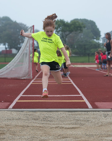 Desi Smith Photo.     Summer Francis 8, competes in the long jump during the Youth Track and Field, held late Wednesday afternoon at the New Balance Track and Field at Newell Stadium.     August 1,2018