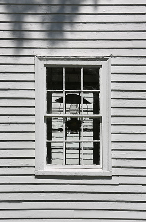 MIKE SPRINGER/Staff photo<br /> A lantern in a window of the Annisquam Historical Society.<br /> 8/10/2018