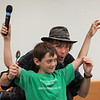 "MIKE SPRINGER/Staff photo<br /> Jim Cruise of Jenison, Michigan, who plays the musical spoons and goes by the stage name ""The Spoon Man,"" gives instructions to his volunteer assistant Amos Telep, 9, during a wrap-up party Friday for the summer reading program at the Sawyer Free Library.<br /> 8/10/2018"