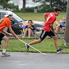 RYAN HUTTON/ Staff photo<br /> The Flyers' Michael Nocella, left, chases the Red Wings' Eric Andrews, right, downcourt during the Young Legends Youth Street Hockey League's finals at the Stage Fort Park basketball courts on Sunday.