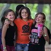 MIKE SPRINGER/Staff photo<br /> From left, Shayla Krasowski, 8, Kaiya Koper, 9, and Kayleigh Thurman, 8, enjoy time together at the Cape Ann YMCA's Camp Spindrift in Gloucester.