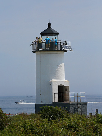 MIKE SPRINGER/Staff photo<br /> A group of volunteer workers take a tour of the lighthouse Wednesday on Straitsmouth Island in Rockport. The island may be opened up to the public next year, after a new boat ramp and other improvements are completed.<br /> 8/8/2018