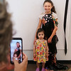 "MIKE SPRINGER/Staff photo<br /> Nine-year-old Daphne Cloutman poses for a photograph with her cousin Isla Miles, 2, following a fashion show Friday at Cape Ann Art Haven. The event wrapped up the annual ""Fashion Week"" at Art Haven. Daphne and other children designed and sewed their own clothes during the week, and showed them to family during the Friday event.<br /> 8/3/2018"