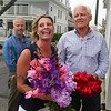 MIKE SPRINGER/Staff photo<br /> Susan Kelly speaks at the grand opening ceremony for the new location of Microsearch as her husband and business partner Chuck, right, looks on Wednesday at 101 Western Avenue in Gloucester. In the background at left is Ken Riehl, chief executive officer of the Cape Ann Chamber of Commerce.<br /> 8/2/2018