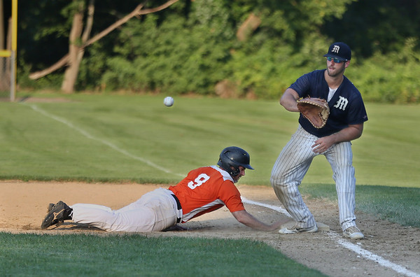 MIKE SPRINGER/Staff photo<br /> Beverly runner Brian Chirco slides back to first as Mariners First baseman Adam Philpott prepares to catch the ball in a pick-off attempt during ITL playoff action Monday in Beverly.<br /> 8/6/2018