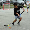 RYAN HUTTON/ Staff photo<br /> The Blackhawks' Gus Nugent heads toward the Rangers' goal during the Young Legends Youth Street Hockey League's finals at the Stage Fort Park basketball courts on Sunday.