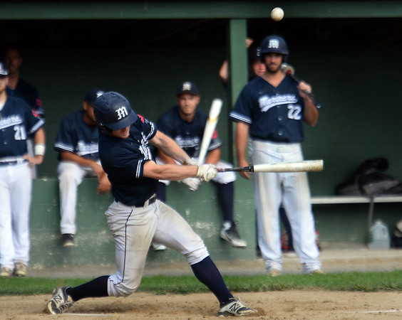 CARL RUSSO/Staff photo Manchester Essex Mariners, Kellen Field takes a hard swing. The Rowley Rams defeated the Manchester Essex Mariners 6-2 in baseball action of game four of the ITL Finals.  8/17/2019