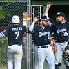 CARL RUSSO/Staff photo Manchester Essex Mariners celebrate with Caulin Rogers after he crossed home plate to score the first run of the game. The Rowley Rams defeated the Manchester Essex Mariners 6-2 in baseball action of game four of the ITL Finals.  8/17/2019